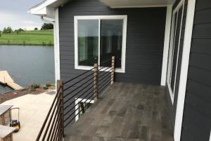 Custom composite deck with wrought iron railing. (54 of 68)