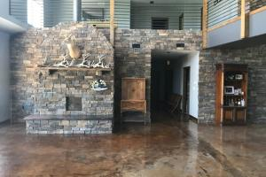 Custom stone fire place and wall. (51 of 68)