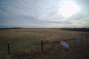 Highway 2 Farm Land and Recreational Property gated entry.  (9 of 13)