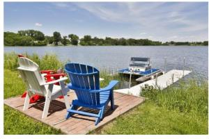 Ag Land; Investment Opportunity; Lakeshore; Hunt; Fish; Hike - I94/Hwy 65, WI:  Pond View Showing Dock and Sitting Area - Cross Creek Cutback Ranch (14 of 15)