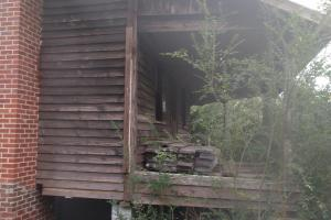 This cabin on the property dates back nearly 100 years (5 of 6)