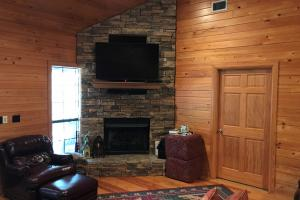 Living room with stone fireplace (3 of 35)
