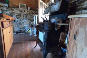 <p>Old stove&nbsp;in kitchen,&nbsp;Mountain Pasture with Panoramic Views and Waterfalls</p>