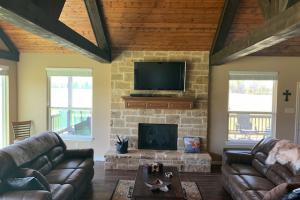 Custom built cabin living room with exposed beams at Purtis Creek Ranch (10 of 48)