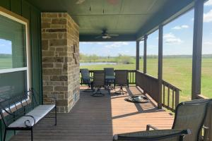 Enjoy a cup of coffee on the front porch while you enjoy the countryside views of Purits Creek Ranch. (9 of 48)