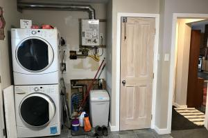 Huntsman home features on-demand hot water, soft water system. Washer and dryer included with home.  (27 of 48)