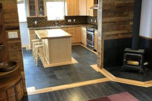 Huntsman home features milled original schoolhouse flooring for trim around slate flooring. (11 of 48)