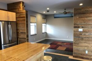 Huntsman home utilizes original wood floor from schoolhouse for accent walls (8 of 48)
