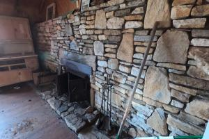 Large stone hearth in the cabin (60 of 74)