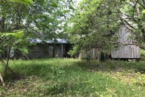 Rear View of Home in Disrepair Built in 1922 That Has Been Used as a Hunting Camp in Recent Years - +/- 39 Acres Near Camden in Madison County, MS (4 of 10)