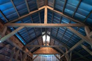 Metal roof and post and beam construction - Secluded Mountain Cabin on 103 Acres with Pond and Creek (32 of 49)