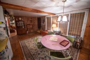 Entry and dining area - Secluded Mountain Cabin on 103 Acres with Pond and Creek (18 of 49)