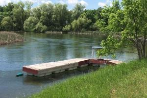 9.21 Acre Resid/Recreational Site w-Otter Tail River on 3 Sides! 28120 Redhead Dr, Underwood, MN: floating dock-river view (2 of 6)