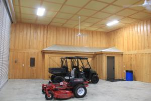 25 foot roll up garage doors with concrete slab and fans and lights. (19 of 37)