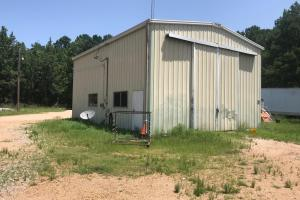 This 30' x 40' multipurpose metal building is located on the property just off CR 92 in a storage yard near the intersection of Hwy 8 and the Natchez Trace Parkway. (4 of 22)