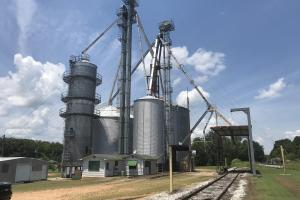The Headquarters Farm includes a grain elevator and dryer located on two acres along the railroad in Okolona. It includes two 11,000 bushel hopper tanks, a 230,000 bushel bin and 100,000 bushel bin, scales, 80' dumper, hydraulic probe and a winch that will move eight loaded rail cars. (2 of 27)