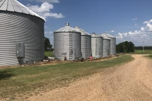 Located at the headquarters are six grain bins. Two are 10,000 bushel, two are 7,500 bushel, one 4,500, and one 3,500. All have metal floors except the 4,500 bushel bin.  (16 of 27)