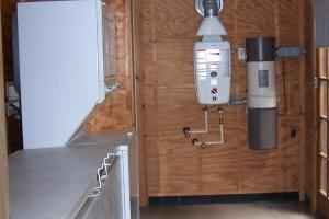 Utility room with central vacuum and water heater