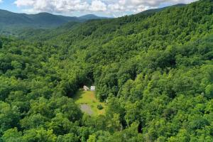 Secluded 102.95 Acre Mountain Escape with Pond and Creek