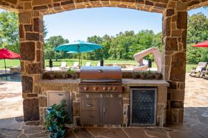 Entertaining at it's finest with this outdoor kitchen featuring bar top for your guests.  (15 of 30)