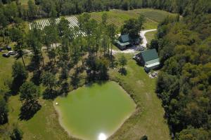 View of Pond, Processing Facility, and Cabin (26 of 71)