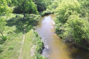 <p>Aerial view of live creek that never freezes and flows continously through property.&nbsp;</p>