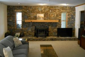 <p>Stone hearth and wood stove in smaller cabin supplements the heat if necessary.</p>