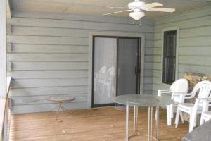 <p>Back porch of cabin opens into bedroom and mud room/kitchen.</p>