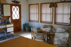 <p>Spacious eat-in kitchen in the main house. Dining area large enough to seat 10 or more, with 4 additional seats at the island. There is plenty of room to entertain!</p>