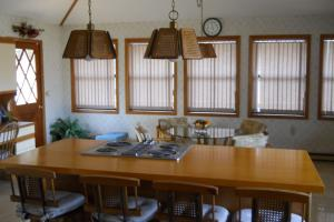 <p>Kitchen island seats 4 and has a Jenn-Air.</p>