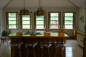 <p>Spacious kitchen of the main house - Jenn-Air, island seating, and eat-in large enough for table seating 10</p>