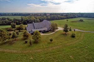 Executive Home with Farm and Pond near Carl Junction